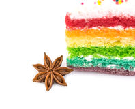 Star  anise  with  rainbow cake  isolated on white background Stock Photos