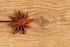 Star anise on rustic wood. Star anise on old weathered wood Royalty Free Stock Photography