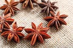 Star anise on a sackcloth. Dried star anise on a sackcloth Royalty Free Stock Photo