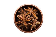 Star anise spice in wooden bowl, isolated on white background. S. Star anise seasoning in a wooden bowl, top view. spice isolated on white royalty free stock photos