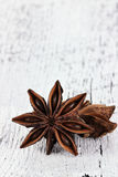 Star Anise Spice. Over a white wooden background. Copyspace available Stock Images