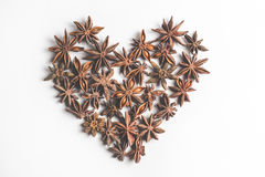 Star anise spice in the form of heart fruits and seeds, isolated on a white background closeup Royalty Free Stock Image