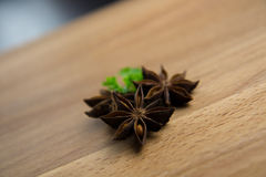 Star anise spice fruits. And seeds on wood background Royalty Free Stock Images