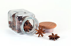 Star anise in spice jar. Star anise in a jar for spices on a white background Stock Photo