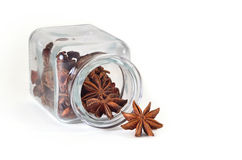 Star anise in spice jar. Star anise in a jar for spices on a white background Stock Photography