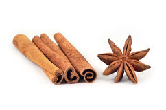 Star anise (spices). Cinnamon sticks and star anise on a white background Stock Images