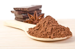 star of anise, tower from chocolate and cacao powder Royalty Free Stock Image