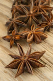 Star anise on wood background Royalty Free Stock Image