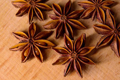 Star Anise on the Wooden Background Stock Image