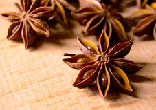 Star Anise on the Wooden Background Royalty Free Stock Photos
