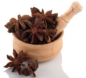 Star anise in a wooden bowl on a white background. royalty free stock images