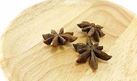 Star anise on wooden plate Royalty Free Stock Image