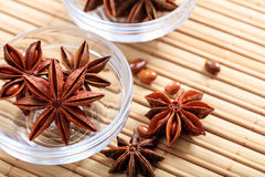 Star anise on a wooden surface. Dried star anise on a wooden surface Royalty Free Stock Photography