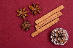 Star anises, cinnamon sticks and cone Stock Photo