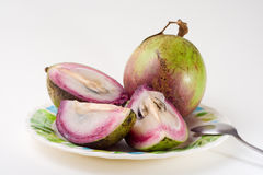 Star Apple - Fruit. Food Related - Star Apple Fruit Served on a Plate Royalty Free Stock Images