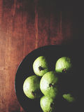 Star apple on wooden table Stock Image