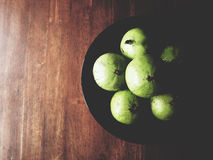 Star apple on wooden table Royalty Free Stock Images