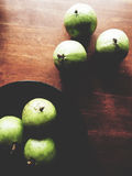 Star apple on wooden table. Green Star apple on wooden table Stock Image