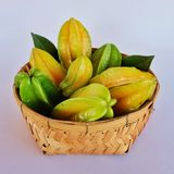 Star apples. Tropical fruits in bamboo basketwork Stock Image