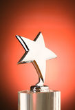 Star award against red background