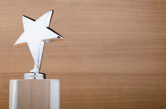Star award against wood. En background Stock Image