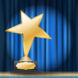 Star award on blue curtain background. Golden star award on blue curtain background Stock Photos