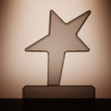 Star Award Trophy with backlight over Wall. 3d Rendering Stock Images