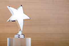 Star award on the  wooden background Royalty Free Stock Photo