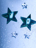 Star Background. Blue sequin stars on a mirror with glitter royalty free stock photography