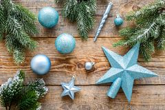 Star and balls for christmas tree near pine branches on wooden background top view Stock Photo