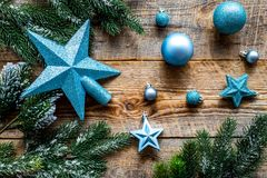 Star and balls for christmas tree near pine branches on wooden background top view Royalty Free Stock Photo