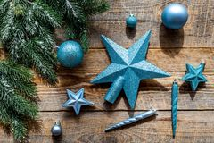 Star and balls for christmas tree near pine branches on wooden background top view Stock Images