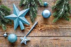 Star and balls for christmas tree near pine branches on wooden background top view copyspace Stock Image