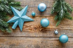 Star and balls for christmas tree on pine branches on wooden background top view copyspace Stock Photography