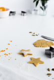 Star Biscuits Flavoured with Orange Zest and Cardamom on White Table Royalty Free Stock Image