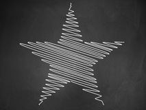 Star on blackboard Stock Photo