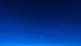Star in blue sky night time scene Royalty Free Stock Images