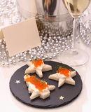 Star bread with red caviar, Champagne, card Royalty Free Stock Photo