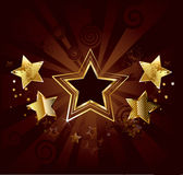 Star on a brown background. Dark star with  gold stars on old brown background Stock Photos