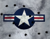 Star on brushed metal. Great image USAF star roundel on grunge  metal with bullet holes Stock Image