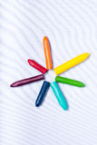 Star burst crayons. Crayons organized in a star pattern on a white backdrop Stock Photography