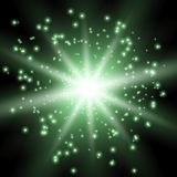 Star burst with sparks, green color. Star burst with sparks, light effect on black background, green color Stock Photo