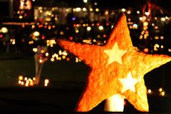Star candle in atmospheric candlelights Stock Images