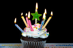 Star candle on birthday cupcake Stock Photo