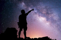 Star-catcher. A person is standing next to the Milky Way galaxy Royalty Free Stock Images