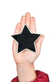 Star in a child's hand with space for your text Stock Image