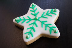 Star christmas Cookie. White and green lines with dark background, dessert Royalty Free Stock Image