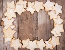 Star Christmas cookies. Framed on wooden background stock photo