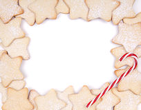 Star Christmas cookies and candy canes. Framed on white background stock images