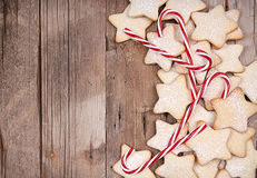 Star Christmas cookies and candy canes. Framed on wooden background Royalty Free Stock Images